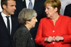 Merkel, Macron and May show support for Spain over Catalan crisis