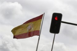 Spain seeks to restore calm after S&P downgrade