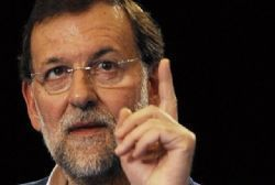 Spain's Rajoy sees growth of at least 2 pct next year